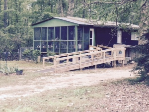 house in the country with long wheelchair ramp