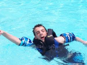 Nick swimming in a pool