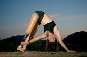 a girl with a physical disability doing yoga