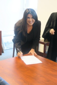 Lisa Goodman signing the official documents