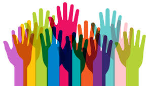 Many hands of all different colors are outstretched and overlapping